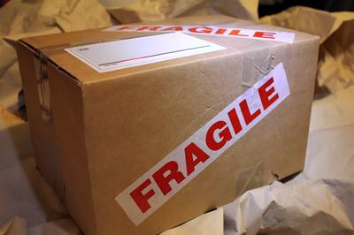 Cardboard box with a Fragile sticker