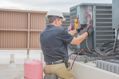 Technician fixing equipment at a storage facility