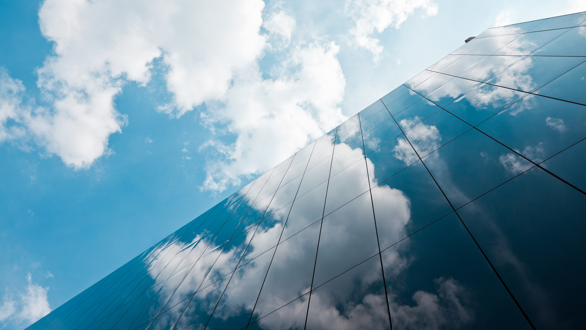 A building reflecting clouds