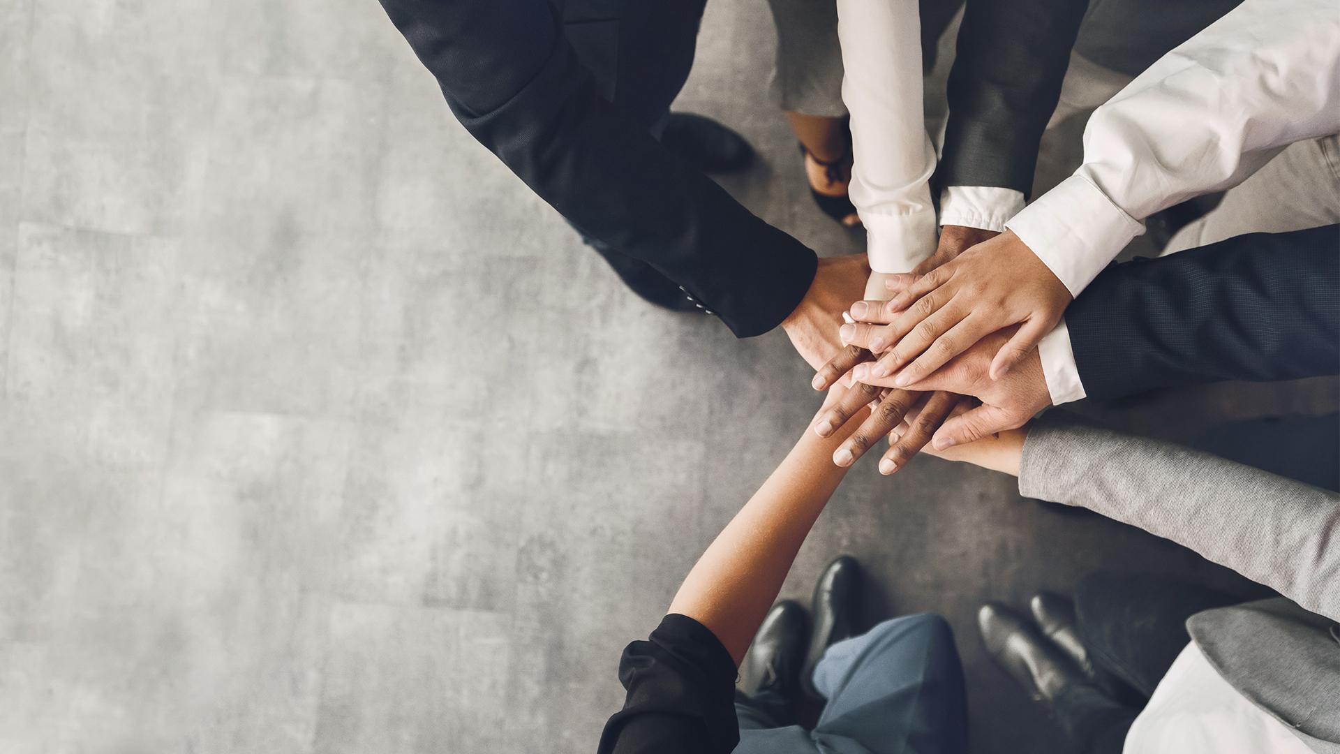 Team huddle hands together