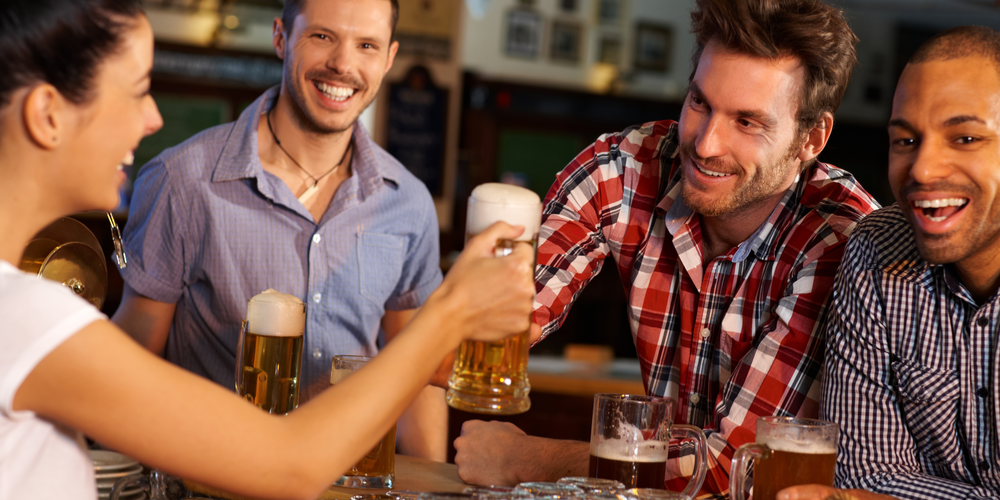 Friends toasting with beer mugs