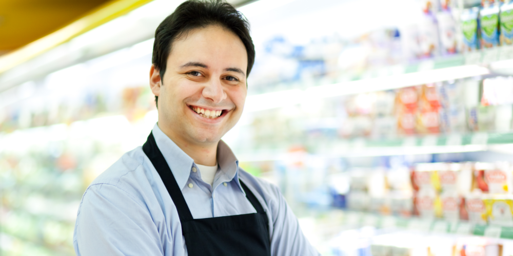 Male cashier smiling