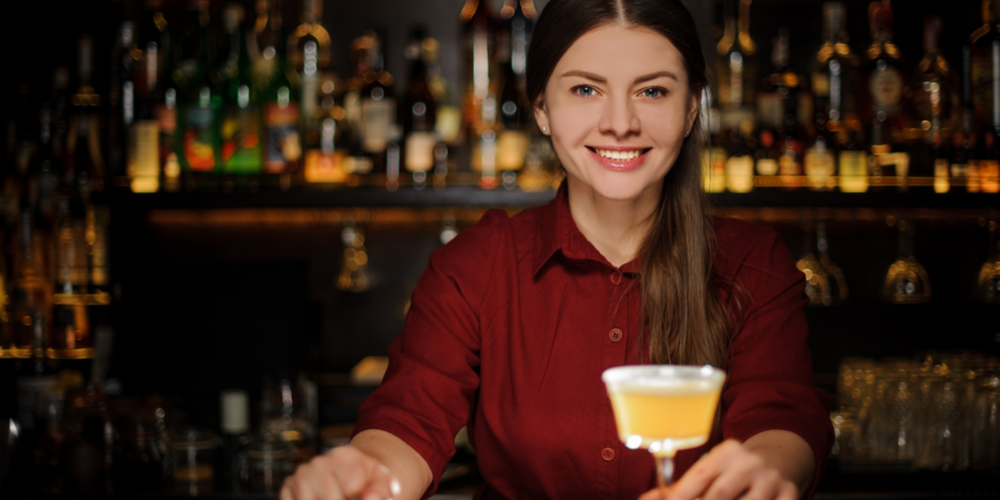 Woman bartender with drink