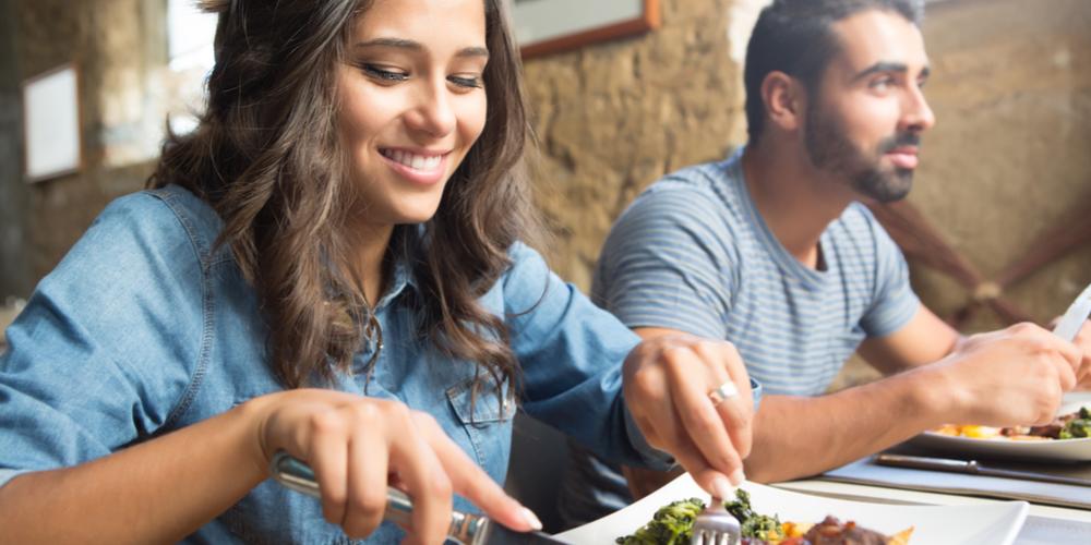 Female eating food at restaurant