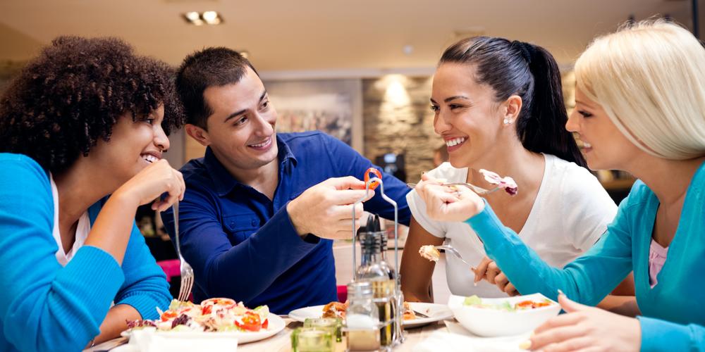 Family enjoying meal at restaurant