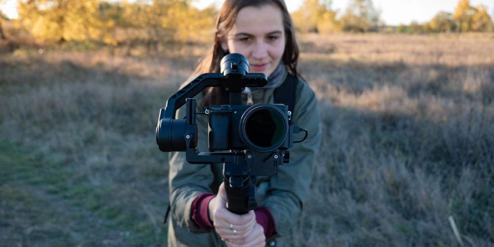 Woman holding video camera