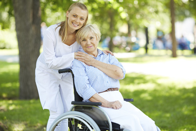 Helper and woman in wheelchair