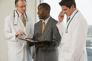 Doctors with businessman