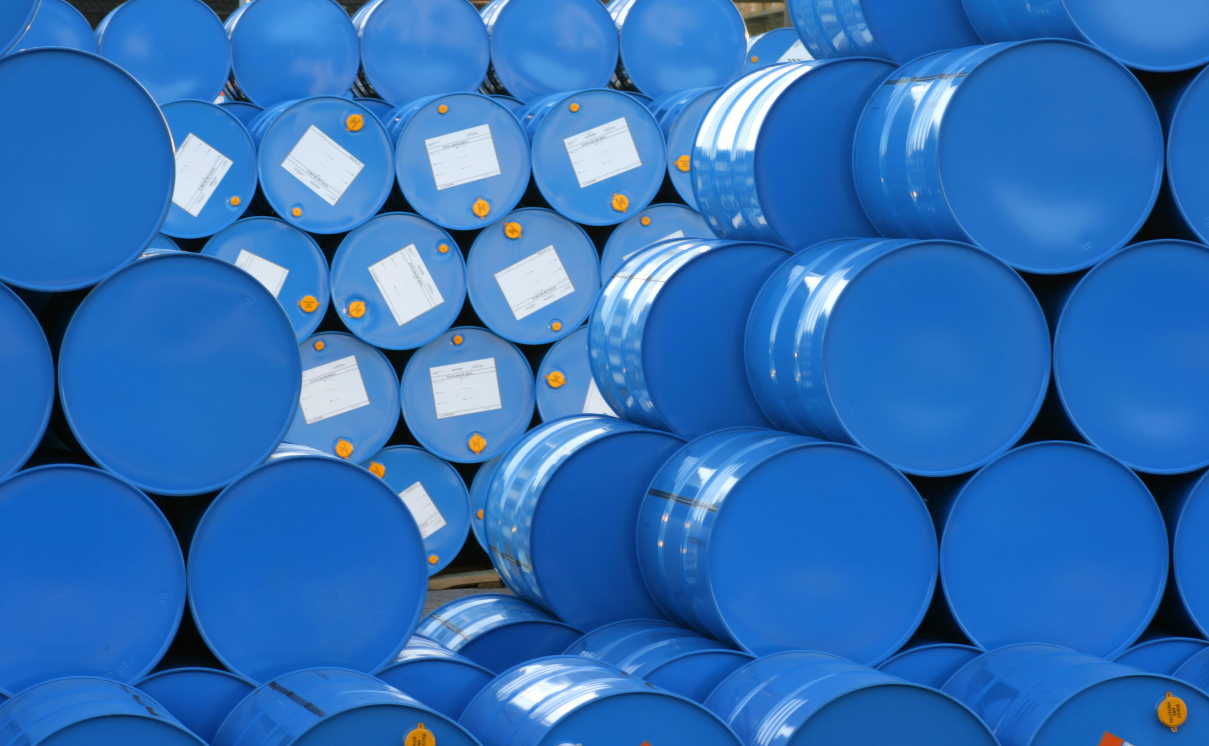 blue barrels with white labels