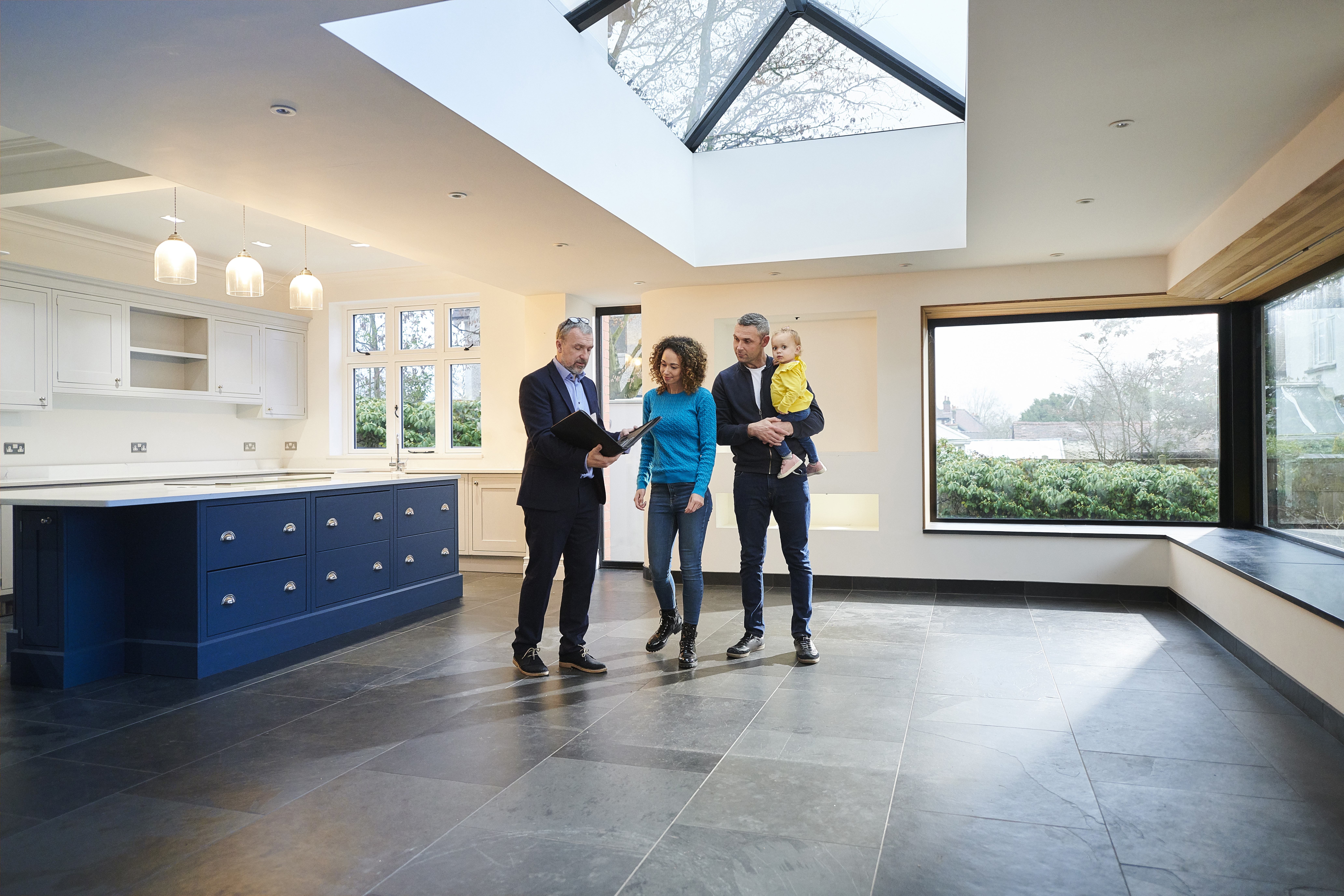Three people in a luxury home