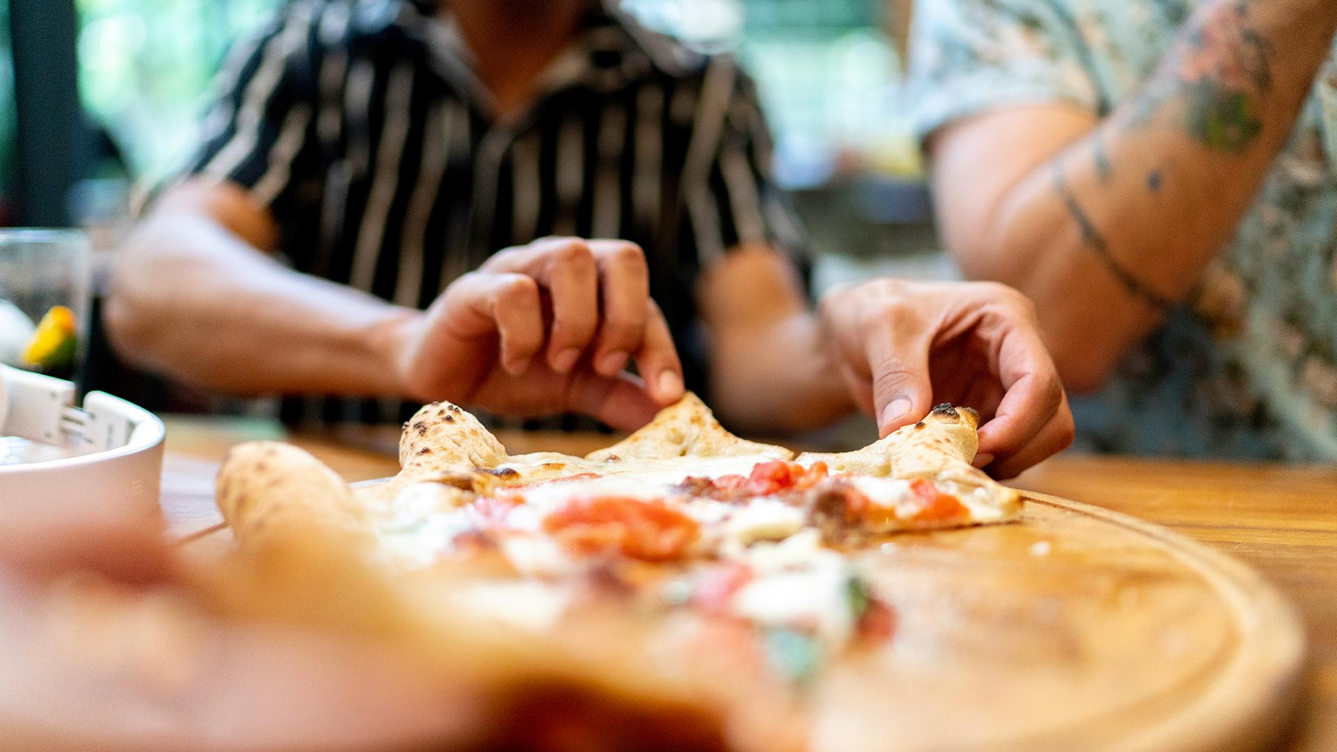People enjoying pizza