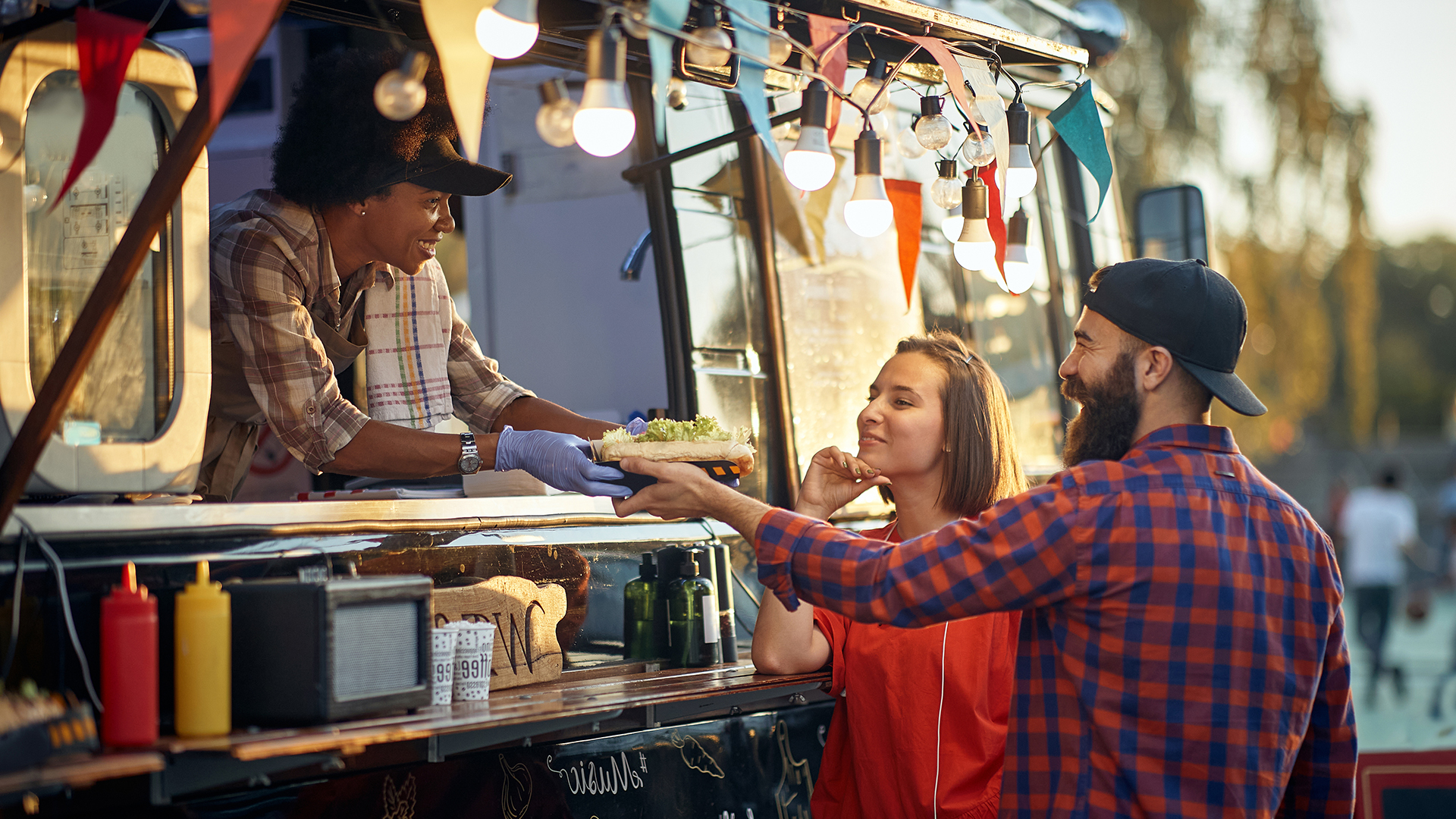 Couple buying from a food truck