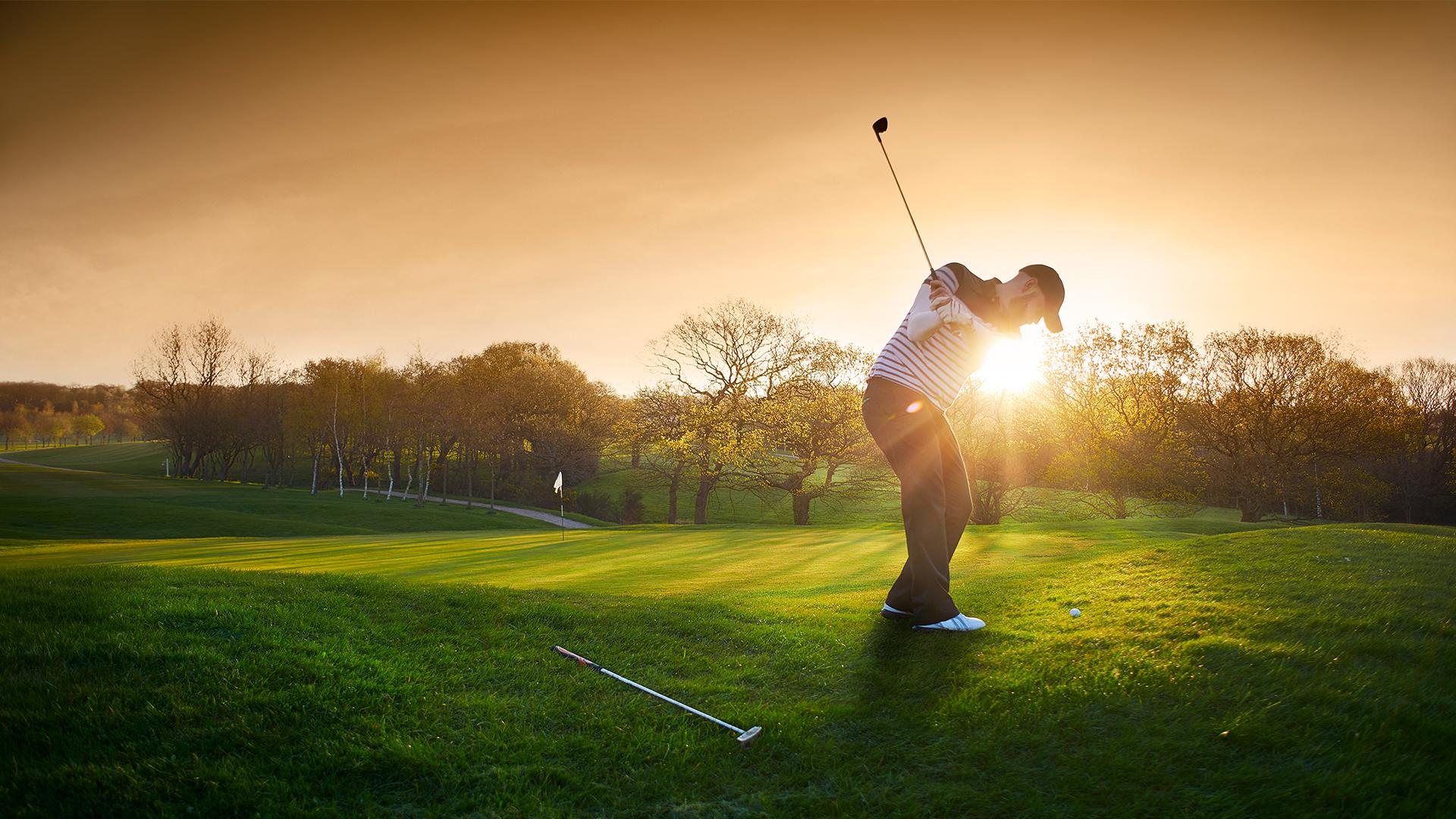 Golfer in sunset